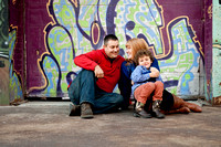 family of three in cool downtown setting